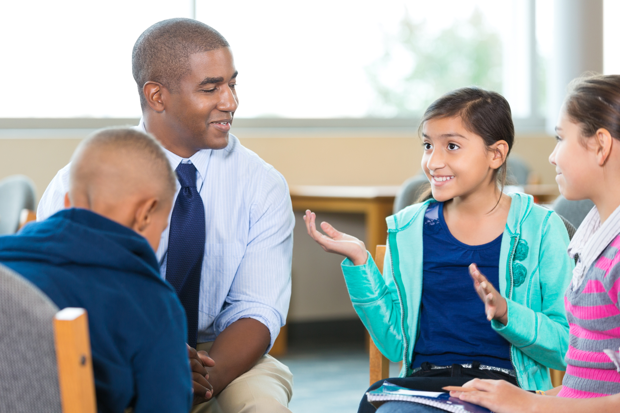 Elementary-age-kids-talking-to-counselor-during-group-therapy-session-501249608_2125x1416